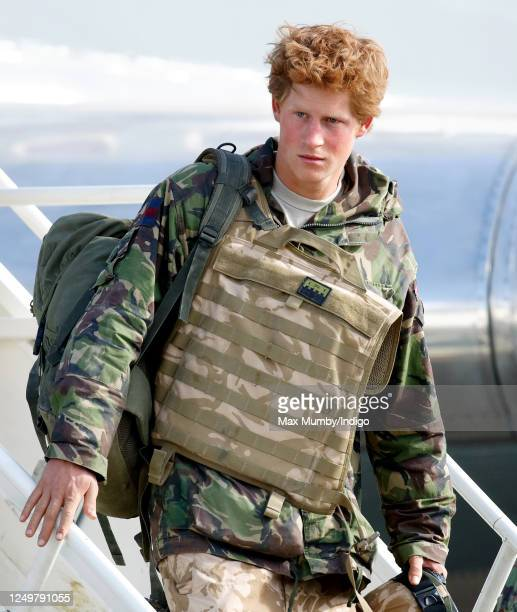 Prince Harry carrying his rucksack and wearing a flak jacket disembarks an RAF Lockheed TriStar transport aircraft as he returns to RAF Brize Norton...