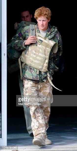 Prince Harry carrying his rucksack and wearing a flak jacket returns to RAF Brize Norton after spending 10 weeks on active duty in Afghanistan on...