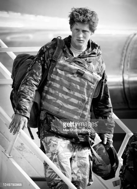 Prince Harry carrying his rucksack helmet and wearing a flak jacket disembarks an RAF Lockheed TriStar transport aircraft as he returns to RAF Brize...