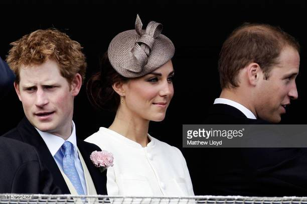 Prince Harry Catherine Duchess of Cambridge and Prince William Duke of Cambridge wait for the start of the Epsom Derby at Epsom Downs racecourse on...
