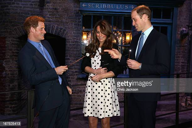 Prince Harry Catherine Duchess of Cambridge and Prince William Duke of Cambridge share a joke on the set used to depict Diagon Alley in the Harry...