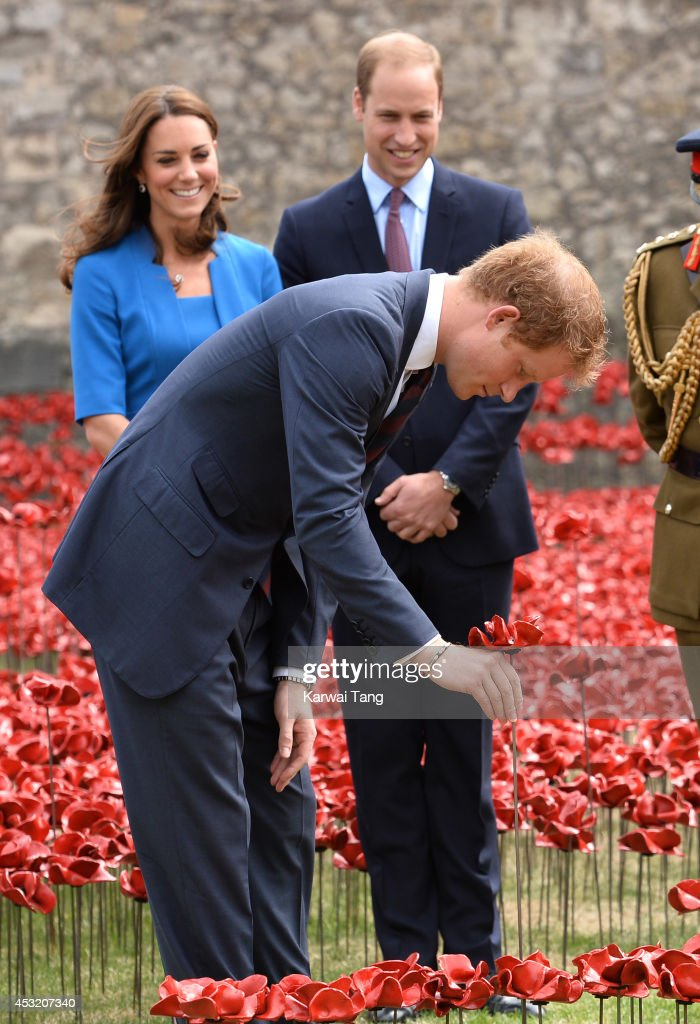 Prince Harry, Catherine, Duchess of Cambridge and Prince William, Duke of Cambridge visits the Tower of London's 'Blood Swept Lands and Seas of Red' poppy installation in the Tower of London's moat on August 5, 2014 in London, England.