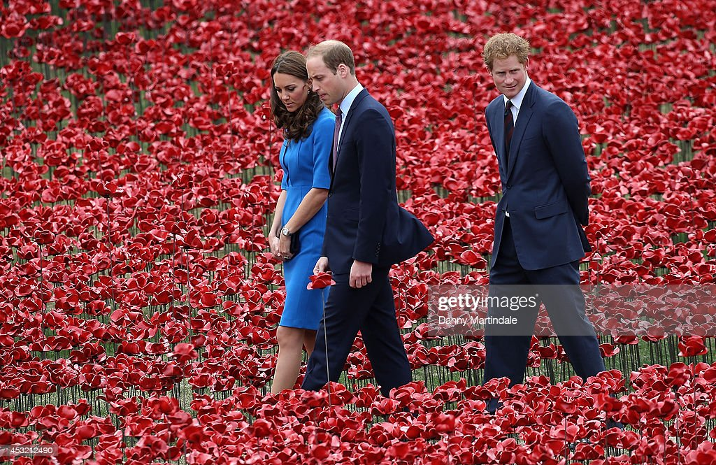 Prince Harry, Catherine, Duchess of Cambridge and Prince William, Duke of Cambridge attend the ceramic poppy field of remembrance at Tower of London on August 5, 2014 in London, England.