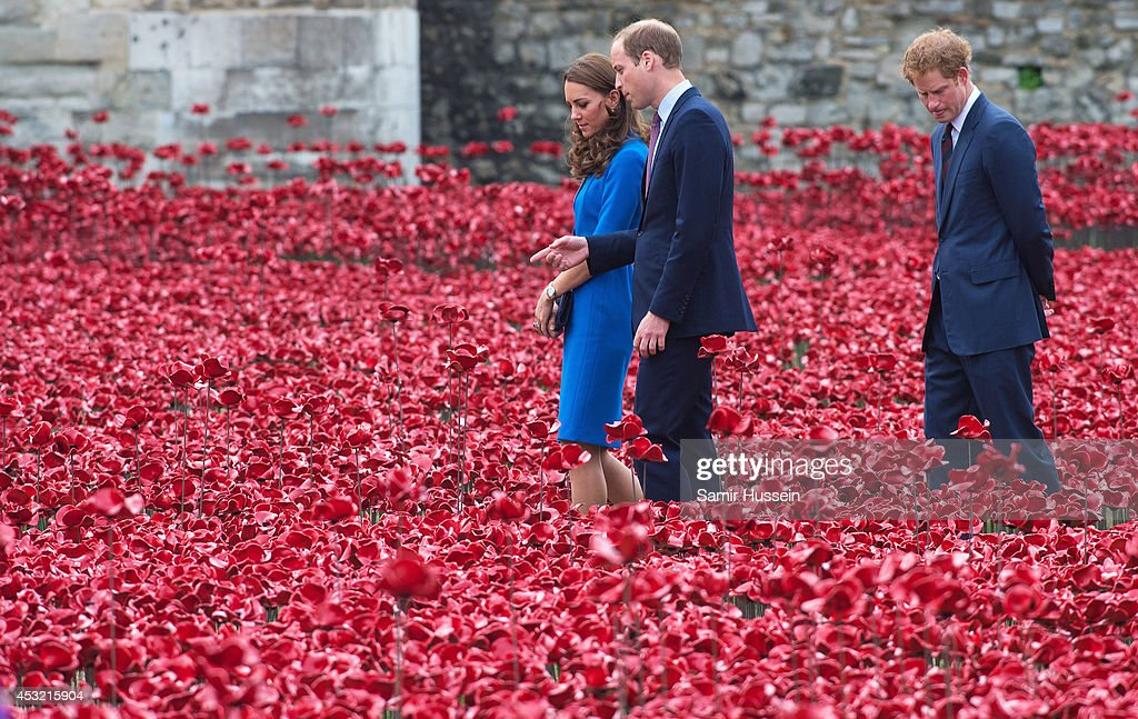 Prince Harry, Catherine, Duchess of Cambridge and Prince William, Duke of Cambridge visit The Tower Of London's Ceramic Poppy installation 'Blood Swept Lands and Seas of Red' by artist Paul Cummins, commemortating the 100th anniversary of the outbreak of First World War on August 5, 2014 in London, England.