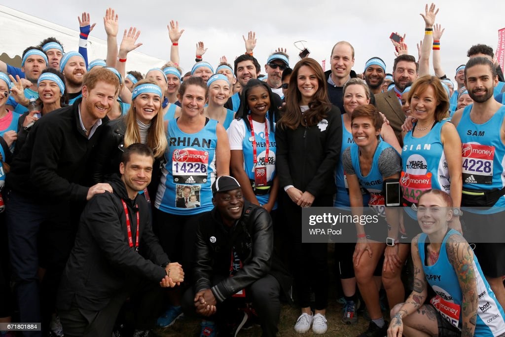 Prince Harry, Catherine, Duchess of Cambridge and Prince William, Duke of Cambridge pose for a photograph with runners representing the charity 'Heads Together' before officially starting the The Virgin Money London Marathon 2017 on April 23, 2017 in London, England.