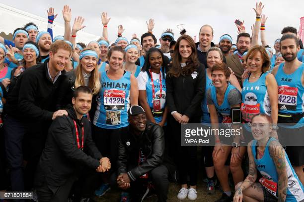 Prince Harry Catherine Duchess of Cambridge and Prince William Duke of Cambridge pose for a photograph with runners representing the charity 'Heads...