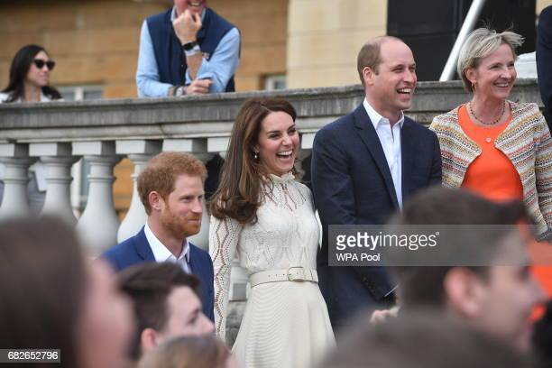 Prince Harry Catherine Duchess of Cambridge and Prince William Duke of Cambridge are seen at a tea party in the grounds of Buckingham Palace to...