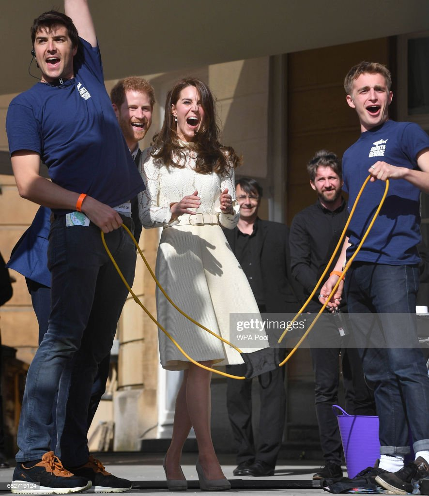 Prince Harry, Catherine, Duchess of Cambridge and Prince William, Duke of Cambridge laugh as they host a tea party in the grounds of Buckingham Palace to honour the children of those who have died serving in the armed forces on May 13, 2017 in London, England.
