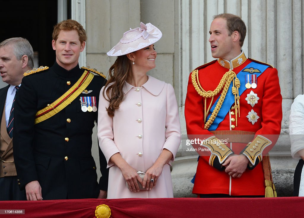 Prince Harry, Catherine Duchess of Cambridge, and William Duke of Cambridge appear on the balcony of Buckingham Palace after the annual Trooping The Colour ceremony on June 15, 2013 in London, England.