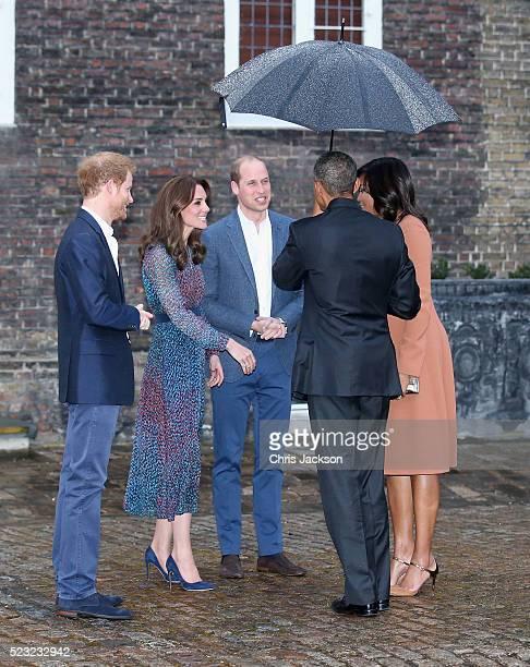 Prince Harry, Catherine, Duchess of Cambridge, Prince William, Duke of Cambridge, US President Barack Obama and First Lady Michelle Obama speak as...