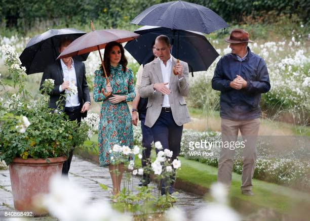 Prince Harry Catherine Duchess of Cambridge Prince William Duke of Cambridge and Prince Harry are seen during a visit to The Sunken Garden at...