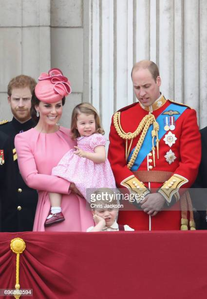 Prince Harry Catherine Duchess of Cambridge Princess Charlotte of Cambridge Prince George of Cambridge and Prince William Duke of Cambridge look out...