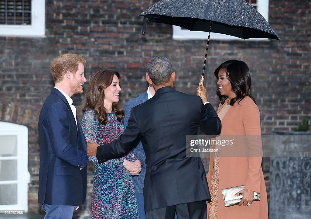 Prince Harry, Catherine, Duchess of Cambridge, US President Barack Obama and First Lady Michelle Obama speak as they attend a dinner at Kensington Palace on April 22, 2016 in London, England.