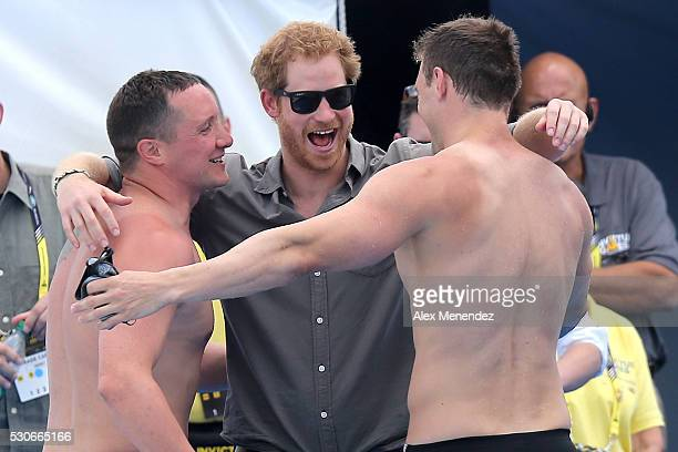 Prince Harry celebrates with United Kingdom winners of the Mixed 4x50 LC Meter Freestyle Relay during the Invictus Games Orlando 2016 Swimming Finals...