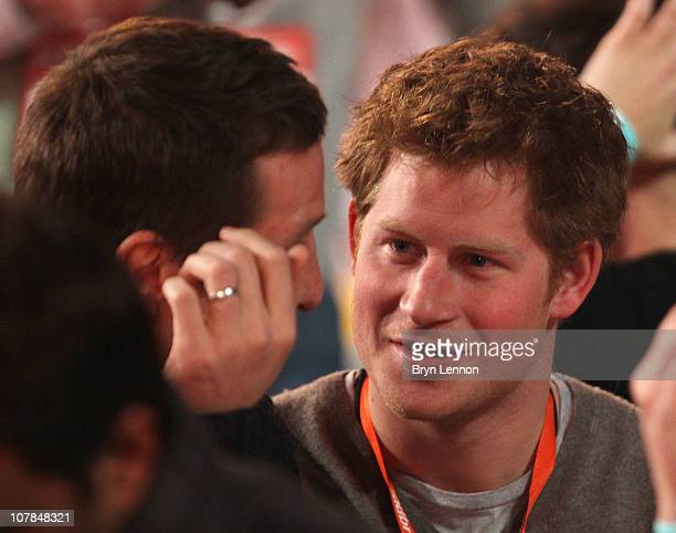 Prince Harry chats former England rugby player Will Greenwood attends the semi finals of the 2011 Ladbrokescom World Darts Championship at Alexandra...