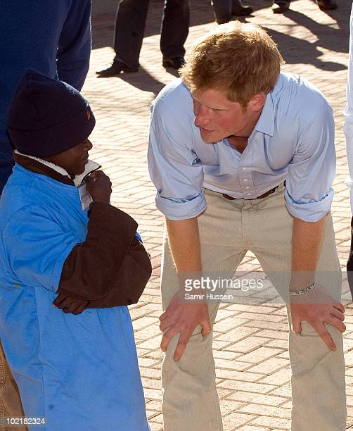 Prince Harry chats to a child at the Mamohato Network Club for children affected by HIV at King Letsie's Palace on June 17, 2010 in Maseru, Lesotho....