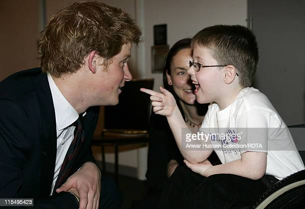 Prince Harry chats to Christopher Anderson who nominated Caroline Anderson for Best Nurse during the WellChild Childrens' Health Awards ceremony at...
