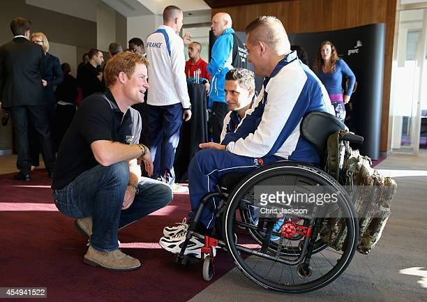 Prince Harry chats to competitors as he welcomes the Team Captains of the 13 nations taking part in the Invictus Games to London at PWC Embankment...