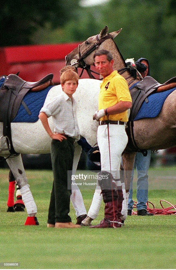 Prince Harry chats to his father Prince Charles at Cirencester Polo Club on June 8, 1997 in Cirencester, England.