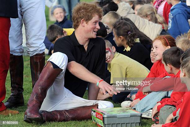 Prince Harry chats to local children after competing in a charity polo match at the the Beaufort Polo Cub on June 22 2008 in Tetbury England