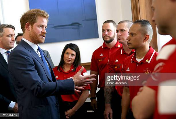 Prince Harry chats to members of the Canadian Invictus team as he attends a reception for supporters and organisers of the Invictus Games Toronto at...