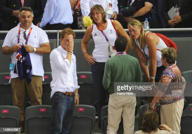 Prince Harry chats to Rowers Katherine Grainger and Anna Watkins of Great Britain at the Track Cycling on Day 11 of the London 2012 Olympic Games at...