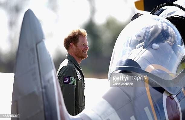 Prince Harry chats to Spitfire pilots as they take off on the airfield at Goodwood Aerodrome during a Battle of Britain Flypast at Goodwood on...