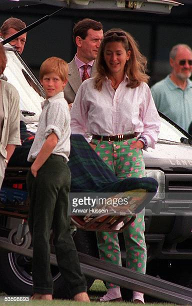 Prince Harry chats to Tiggy LeggeBourke at Cirencester Polo Club on June 8 1997 in Cirencester England