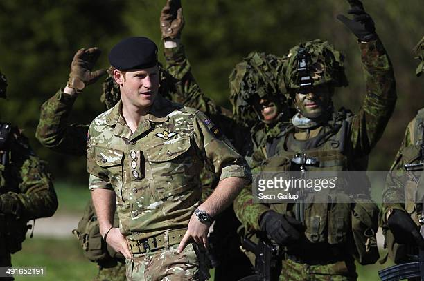 Prince Harry chats with members of the Estonian Scouts Battalion who served in Afghanistan while visiting troops participating in the 'Spring Storm'...