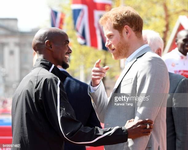 Prince Harry chats with Mo Farah who came third in the Virgin Money London Marathon on April 22 2018 in London England