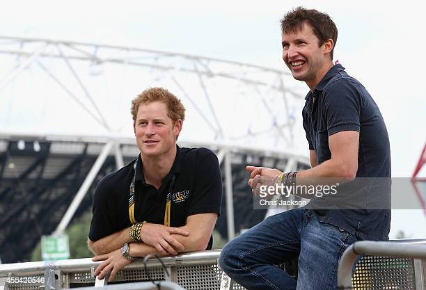 Prince Harry chats with singer James Blunt as he rehearses for the Invictus Games Closing Ceremony during the Invictus Games at Queen Elizabeth park...