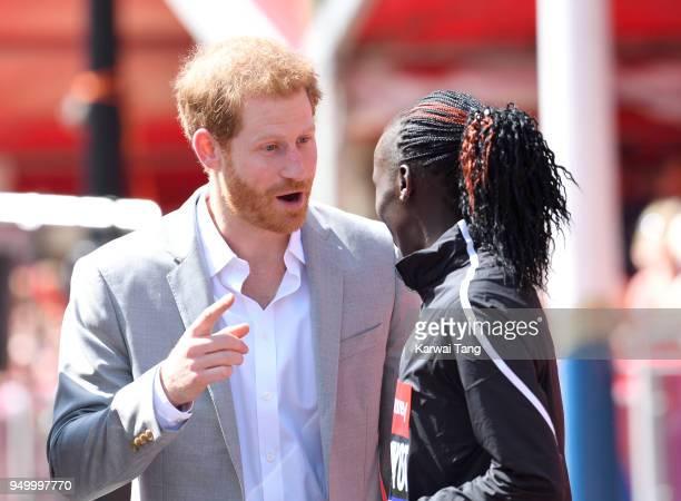 Prince Harry chats with Vivian Cheruiyot, winner of the elite women's race in the Virgin Money London Marathon on April 22, 2018 in London, England.