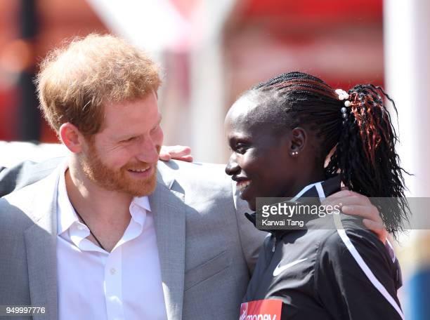 Prince Harry chats with Vivian Cheruiyot winner of the elite women's race in the Virgin Money London Marathon on April 22 2018 in London England