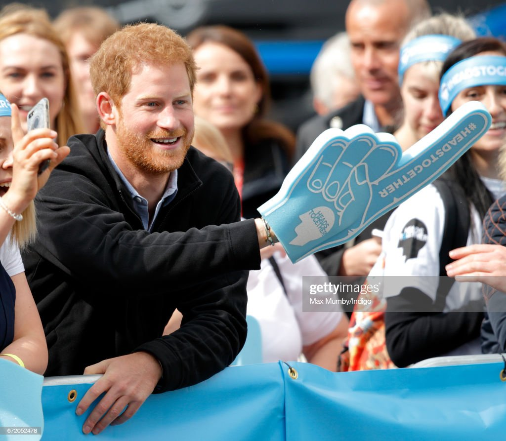 Prince Harry (wearing a giant foam hand) cheers on runners talking part in the 2017 Virgin Money London Marathon on April 23, 2017 in London, England. The Heads Together mental heath campaign, spearheaded by The Duke & Duchess of Cambridge and Prince Harry, is the marathon's 2017 Charity of the Year.