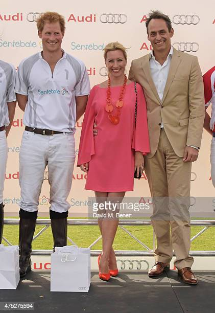 Prince Harry Christine Sieg and Andre Konsbruck Director of Audi UK attend day one of the Audi Polo Challenge at Coworth Park on May 30 2015 in...