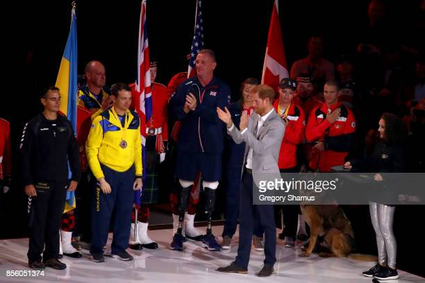 Prince Harry claps for the Parade of the Nations during the closing ceremony of the Invictus Games 2017 at Air Canada Centre on September 30 2017 in...