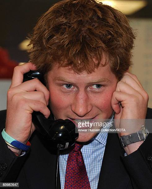Prince Harry closes a deal over the phone at the offices of city traders ICAP on December 10, 2008 in London, England. The Prince attended the 16th...
