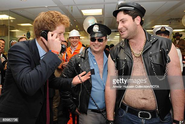 Prince Harry closes a deal with broker Jay Aaronson at the offices of city traders ICAP on December 10, 2008 in London, England. The Prince attended...