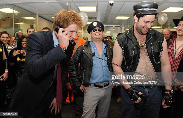 Prince Harry closes a deal with brokers at the offices of city traders ICAP on December 10, 2008 in London, England. The Prince attended the 16th...