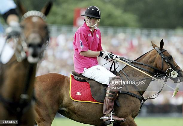 Prince Harry competes during The Cartier Cup between Prince of Wales' Team and Hurlingham Team at the Guards Polo Club on 30 July 2006 in Egham...