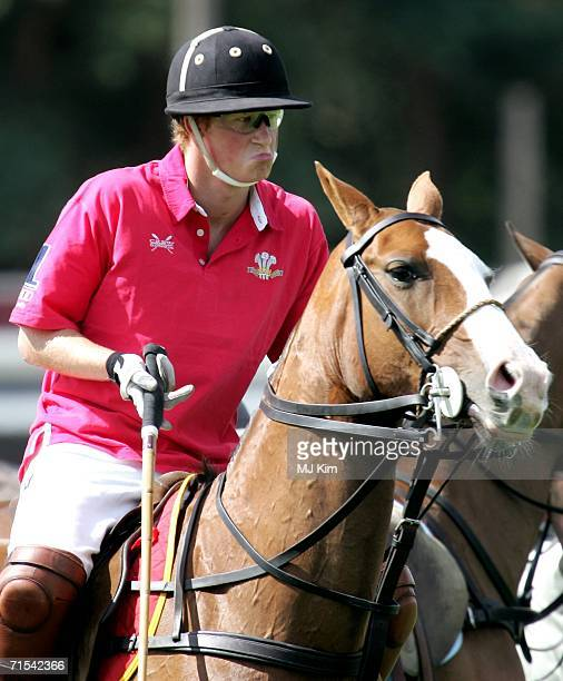 Prince Harry competes during The Cartier Cup between Prince of Wales' Team and the Hurlingham Team at the Guards Polo Club on 30 July 2006 in Egham...