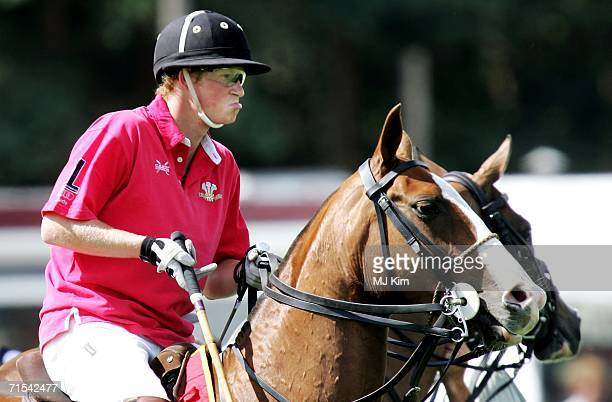 Prince Harry competes during The Cartier Cup match between Prince of Wales' Team and Hurlingham Team at the Guards Polo Club on 30 July 2006 in Egham...