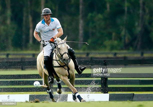 Prince Harry competes during the Sentebale Royal Salute Polo Cup 2016 at the Valiente Polo Farm in Wellington Florida on May 4 2016 / AFP / RHONA WISE