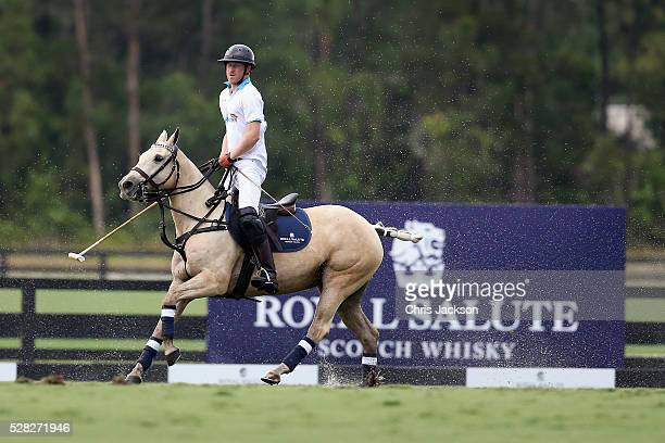 Prince Harry competes during the Sentebale Royal Salute Polo Cup in Palm Beach at Valiente Polo Farm on May 4 2016 in Palm Beach United The event...