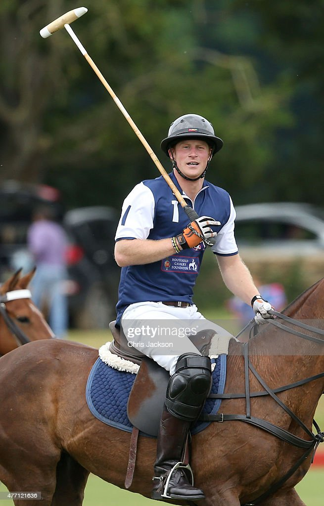 Prince Harry competes for team Royal Salute during the Gigaset Charity Polo Match at Beaufort Polo Club on June 14, 2015 in Tetbury, England.