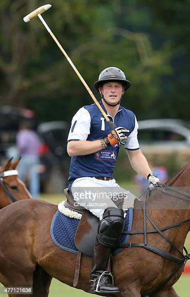 Prince Harry competes for team Royal Salute during the Gigaset Charity Polo Match at Beaufort Polo Club on June 14 2015 in Tetbury England