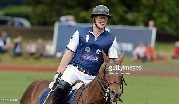 Prince Harry competes in the Gigaset Charity Polo Match at Beaufort Polo Club on June 14 2015 in Tetbury England