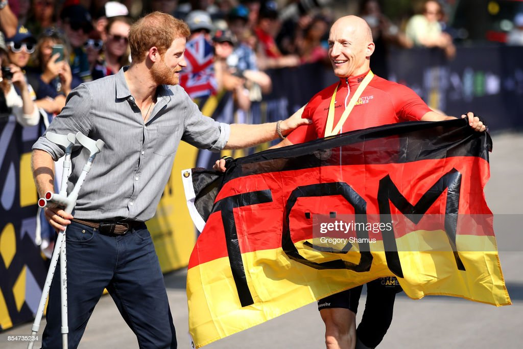 Prince Harry congratulates bronze medalist Thomas Stuber of Germany after competing in Cycling Time Trial during the Invictus Games 2017 at High Park on September 27, 2017 in Toronto, Canada