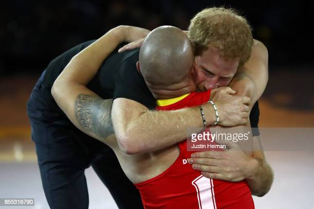 Prince Harry congratulates gold medalist Maurice Manuel of Denmark after defeating Team United Kingdom in the Wheelchair Rugby Final Gold match...