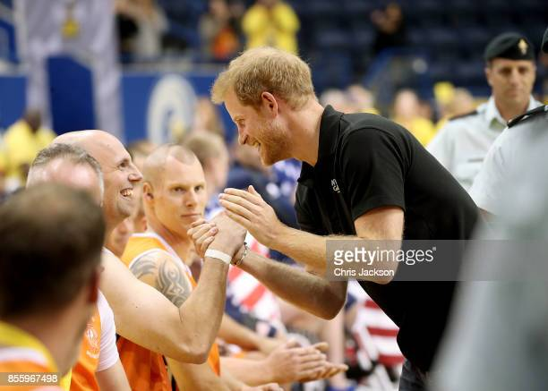 Prince Harry congratulates the competitors at the Wheelchair Basketball Finals during the Invictus Games 2017 at Mattamy Athletic Centre on September...